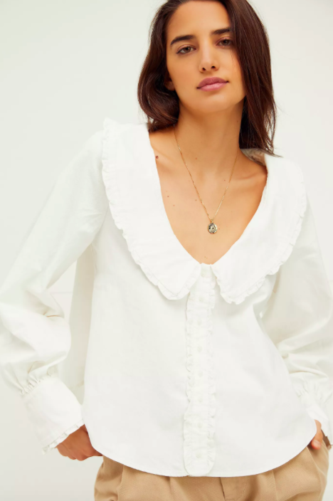 """For showing off just how great that décolletage cream you discovered in quarantine really is. $128, Free People. <a href=""""https://www.freepeople.com/shop/jaimie-blouse/?color=011&type=REGULAR&quantity=1"""" rel=""""nofollow noopener"""" target=""""_blank"""" data-ylk=""""slk:Get it now!"""" class=""""link rapid-noclick-resp"""">Get it now!</a>"""