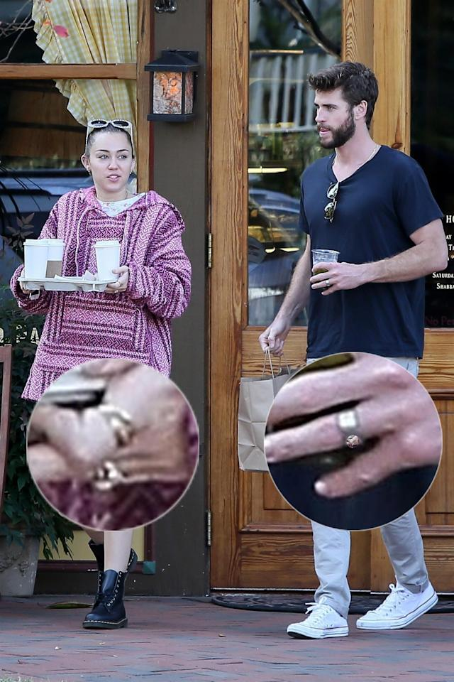 Miley Cyrus and Liam Hemsworth stop to pick up coffees while wearing what look like wedding bands. (Photo: BackGrid)