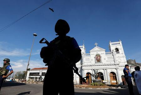 A security officer stands guard in front of St Anthony's shrine in Colombo, after bomb blasts ripped through churches and luxury hotels on Easter, in Sri Lanka April 22, 2019. REUTERS/Dinuka Liyanawatte