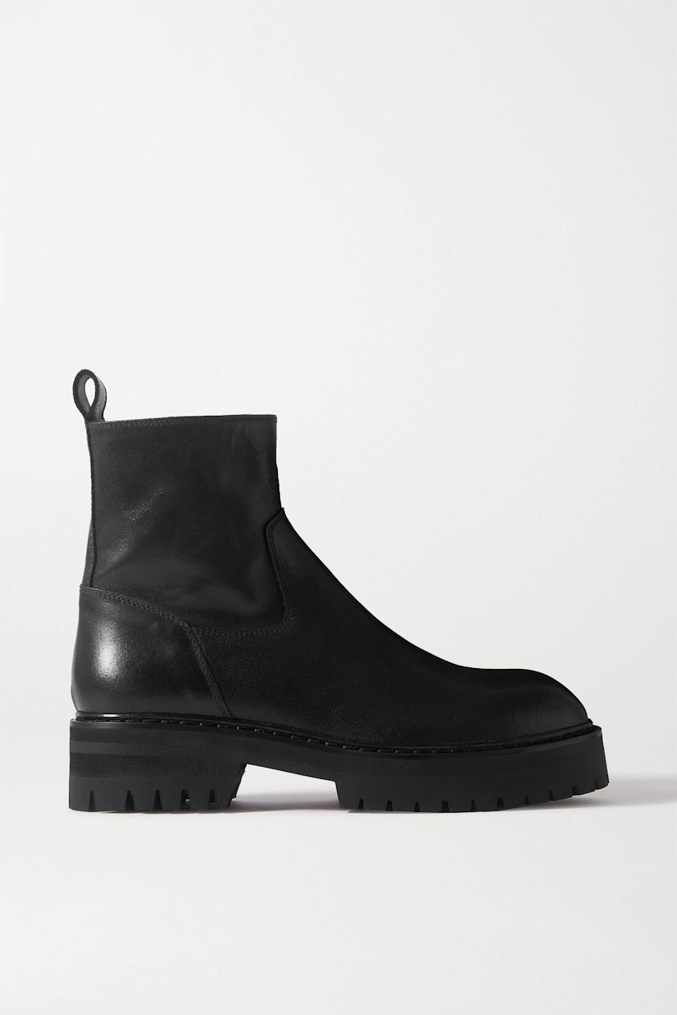"""<p><strong>Ann Demeulemeester </strong></p><p>net-a-porter.com</p><p><strong>$1005.00</strong></p><p><a href=""""https://go.redirectingat.com?id=74968X1596630&url=https%3A%2F%2Fwww.net-a-porter.com%2Fen-us%2Fshop%2Fproduct%2Fann-demeulemeester%2Fshoes%2Fankle%2Fleather-ankle-boots%2F8008779905612307&sref=https%3A%2F%2Fwww.townandcountrymag.com%2Fstyle%2Ffashion-trends%2Fg28225508%2Ffall-boots%2F"""" rel=""""nofollow noopener"""" target=""""_blank"""" data-ylk=""""slk:Shop Now"""" class=""""link rapid-noclick-resp"""">Shop Now</a></p><p>Riff off of the lug sole trend with a pair that has a distinctly borrowed from the boys aesthetic—perfect for adding contrast to a feminine dress. </p>"""