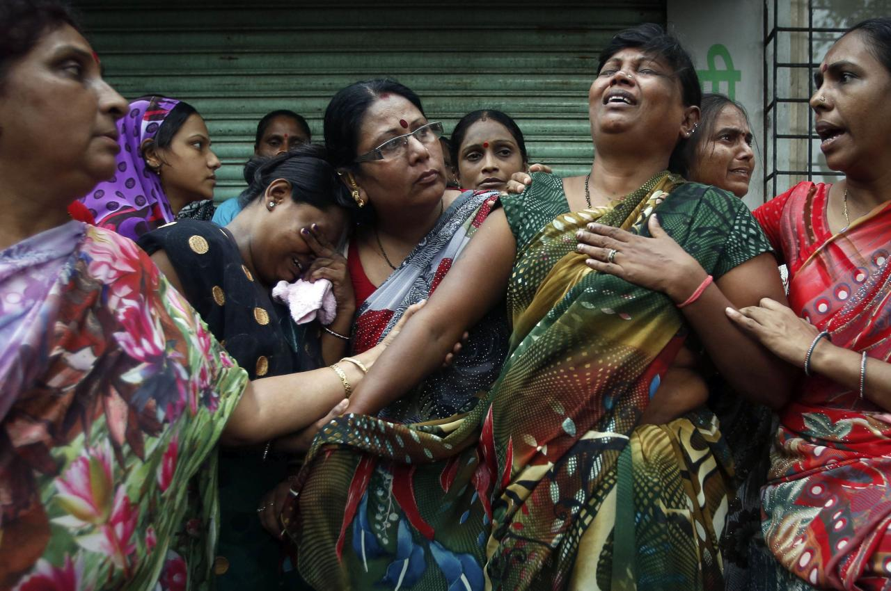 Relatives of residents trapped under the rubble react at the site of a collapsed residential building in Mumbai September 27, 2013. The five-storey apartment block collapsed on Friday in the Indian financial centre of Mumbai, killing one person with dozens feared trapped in the latest accident to underscore shoddy building standards in Asia's third-largest economy. REUTERS/Danish Siddiqui (INDIA - Tags: DISASTER TPX IMAGES OF THE DAY)