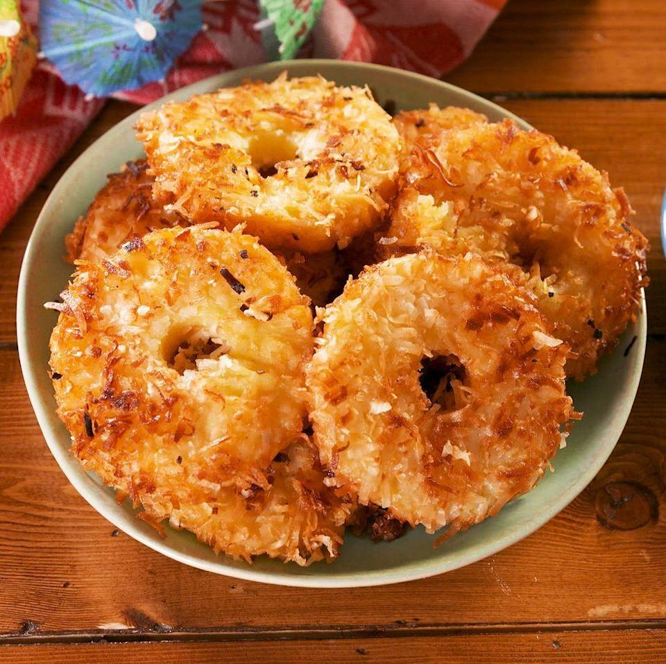 """<p>Fried pineapple rings are first soaked in rum and then dredged in coconut milk and shredded coconut to taste just like your favourite <a href=""""https://www.delish.com/uk/cocktails-drinks/a28885824/pina-colada-recipe/"""" rel=""""nofollow noopener"""" target=""""_blank"""" data-ylk=""""slk:Piña Colada"""" class=""""link rapid-noclick-resp"""">Piña Colada</a>. It's our favourite new way to eat pineapple. </p><p>Get the <a href=""""https://www.delish.com/uk/cooking/recipes/a31257052/fried-pina-colada-rings-recipe/"""" rel=""""nofollow noopener"""" target=""""_blank"""" data-ylk=""""slk:Fried Piña Colada Rings"""" class=""""link rapid-noclick-resp"""">Fried Piña Colada Rings</a> recipe.</p>"""