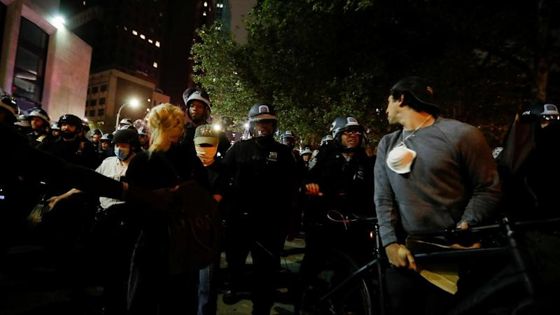 Police confront protesters in the New York City borough of Brooklyn