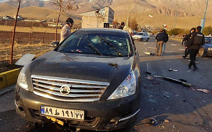 A handout photo made available by Iran state TV (IRIB) shows the damaged car of Iranian nuclear scientist Mohsen Fakhrizadeh after it was attacked - AFP