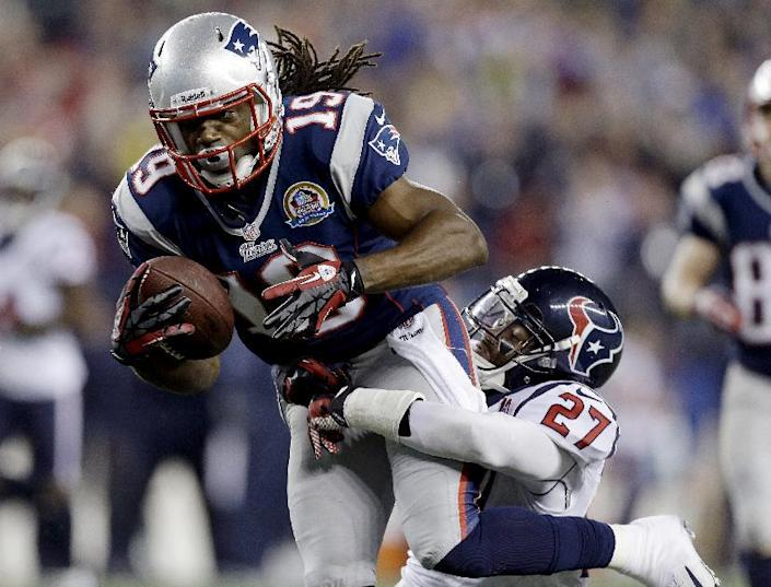 New England Patriots wide receiver Donte' Stallworth (19) dives into the end zone while dragging Houston Texans defensive back Quintin Demps, right, for a touchdown after a catch and run during the third quarter of an NFL football game in Foxborough, Mass., Monday, Dec. 10, 2012. (AP Photo/Elise Amendola)
