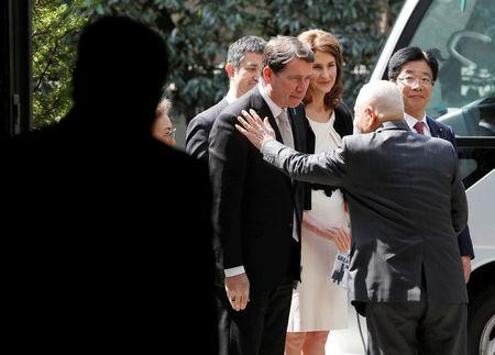 A family member of a Japanese national abducted by North Korean agents greets U.S. ambassador to Japan William Hagerty after their meeting in Tokyo, Japan, April 10, 2018. REUTERS/Kim Kyung-Hoon
