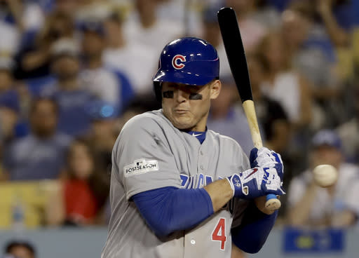 Anthony Rizzo reacts after getting hit by a pitch during Game 2 of the NLCS vs. the Dodgers. (AP Photo/Matt Slocum)