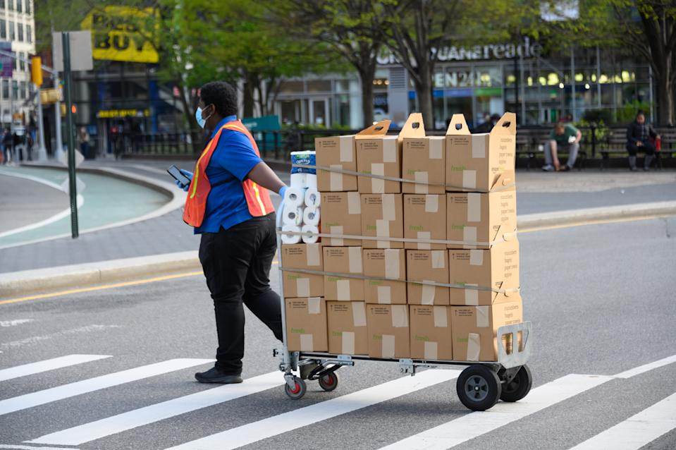 NEW YORK, NY - APRIL 14: Amazon Fresh delivery person works in Union Square during the coronavirus pandemic on April 14, 2020 in New York City. COVID-19 has spread to most countries around the world, claiming over 126,000 lives lost with over 1.9 million infections. (Photo by Noam Galai/Getty Images)