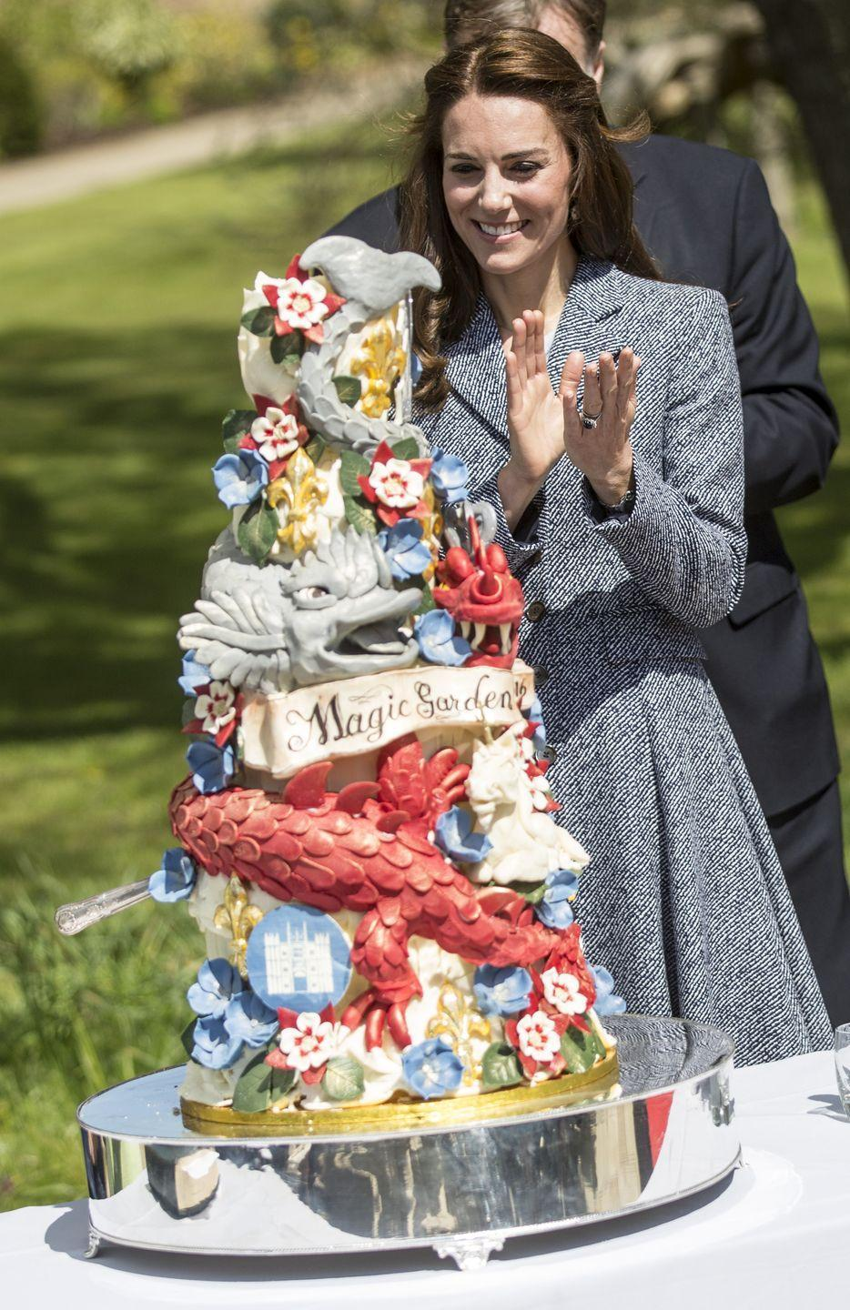 <p>The Duchess clapped for the bakers of this ornate cake, crafted for the opening of the Magic Garden at London's Hampton Court Palace.</p>