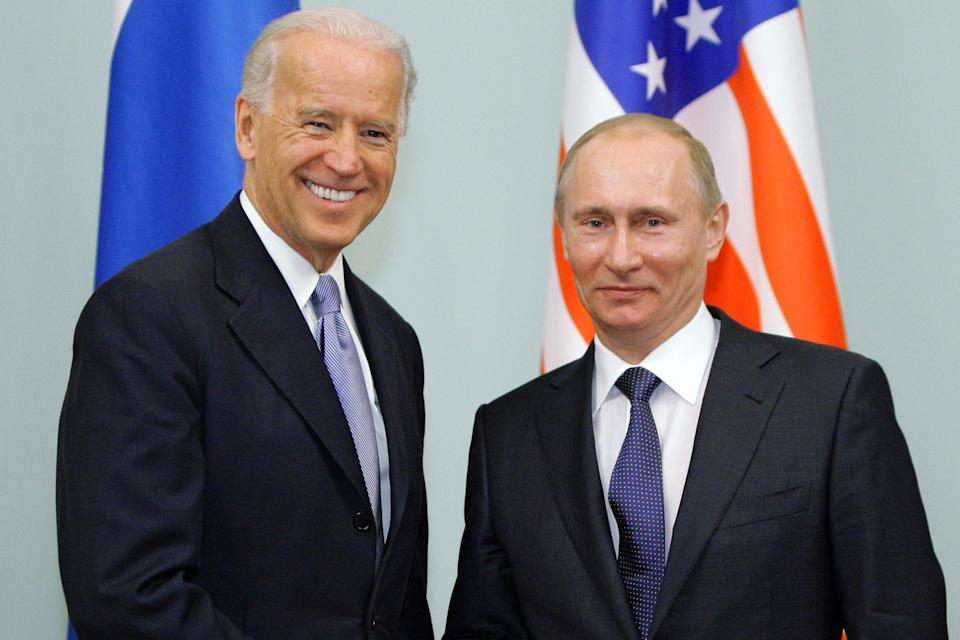 <p>Russian Prime Minister Vladimir Putin shakes hands with US Vice President Joe Biden during a meeting in Moscow (file picture 2011)</p> (POOL/AFP via Getty Images)