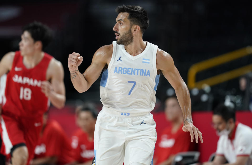 Argentina's Facundo Campazzo (7) celebrates after making a three point basket during men's basketball preliminary round game against Japan at the 2020 Summer Olympics, Sunday, Aug. 1, 2021, in Saitama, Japan. (AP Photo/Charlie Neibergall)