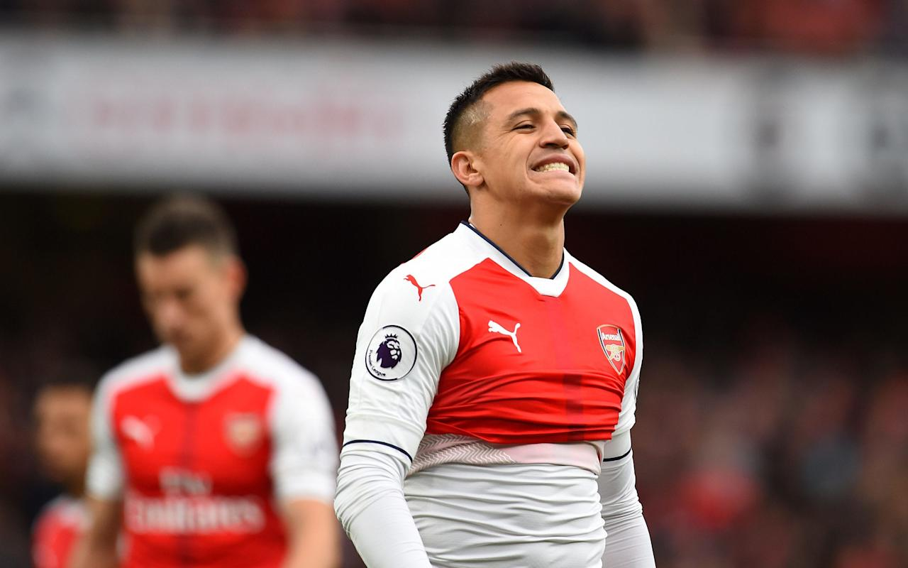 """Wantaway Arsenal strikerAlexis Sanchez has posted aselfie to his Instagram page in which he claims to be """"sick"""". The social mediaupdate comes less than 24 hours after Arsene Wenger revealed he expected the striker to report for pre-season training on Sunday. Arsenal play in the Emirates Cup on Saturday and Sunday this weekendbut the Chilean is not expected to feature after being given an extended summer break after competing in the Confederations Cup. Despite ongoing speculation linking Sanchez with a move away from the Emirates, Wenger said on Thursday that the 28-year-old is due back at training this weekend. Alexis Sanchez looks dejected Credit: PA """"Alexis and Mustafi, their first training session will be on Sunday, the day we play against Sevilla [in the Emirates Cup],"""" Arsene Wenger told Arsenal Player.""""They are practising on the day,"""" he added. However if Sanchez's latest Instagram post is anything to go by, the former Barcelona striker's reunionwith his Arsenal teammates could be in doubt. Enfermo ���������� sick ���������� A post shared by Alexis Sanchez (@alexis_officia1) on Jul 27, 2017 at 6:33pm PDT A glum-looking Sanchez shared a selfie of him and his pet dog along with the caption """"sick"""" and a series of medicine-themed emojis. He also wore a long black scarf to add to the overall effect. The Chilean is consistently one of Arsenal's hardest working players on the pitch and there is no suggestion the striker will miss training on Sunday, however the timing of the post has raised a few eyebrows.  Arsene Wenger insists Alexis Sanchez will not be sold this summer Credit: Getty Images Sanchez has been linked with moves to Manchester City and PSG this summer but Wenger has been unerring in his insistence that the club will not sell the forward. """"Yes, thatis a continuation of what I said at the end of the season. That's what we will do,"""" Wenger said. """"He adds great value to the squad and I think as well he is a great lover of the club. """"The players have contrac"""