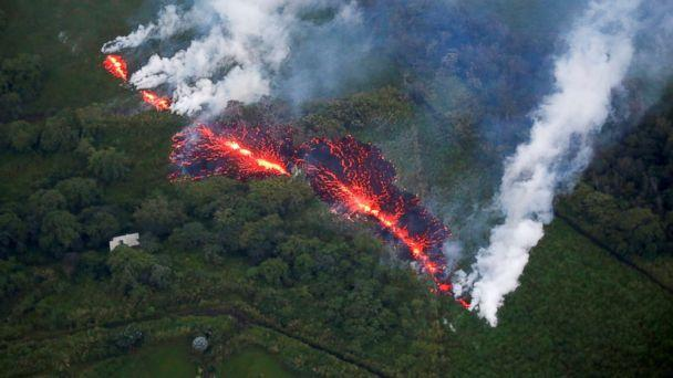 PHOTO: Lava erupts from a fissure east of the Leilani Estates subdivision during ongoing eruptions of the Kilauea Volcano in Hawaii, May 13, 2018.   (Terray Sylvester/Reuters)