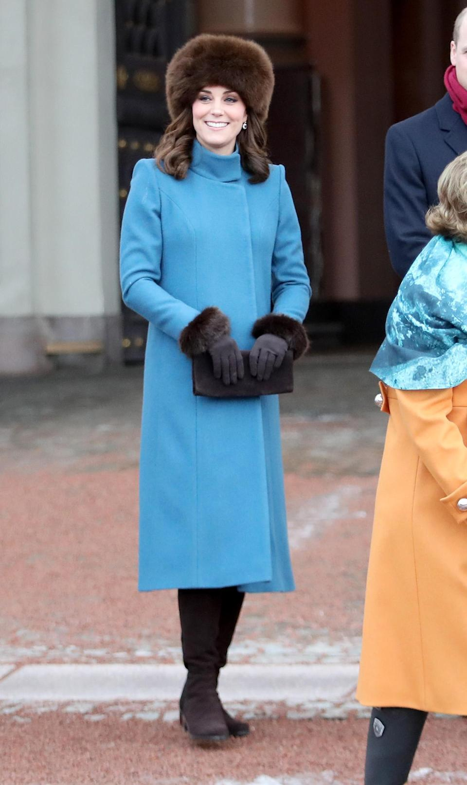 <p><strong>The occassion:</strong> At the Princess Ingrid Alexandra Sculpture Park within the Royal Palace Gardens on day three of the Duke and Duchess's visit to Sweden and Norway.<br><strong>The look:</strong> A sky blue Catherine Walker coat with a fur hat. <br>[Photo: Getty] </p>
