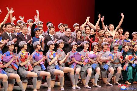 North Korean leader Kim Jong Un, his wife and head of the China's Communist Party's International Department Song Tao applauds with ballet dancers