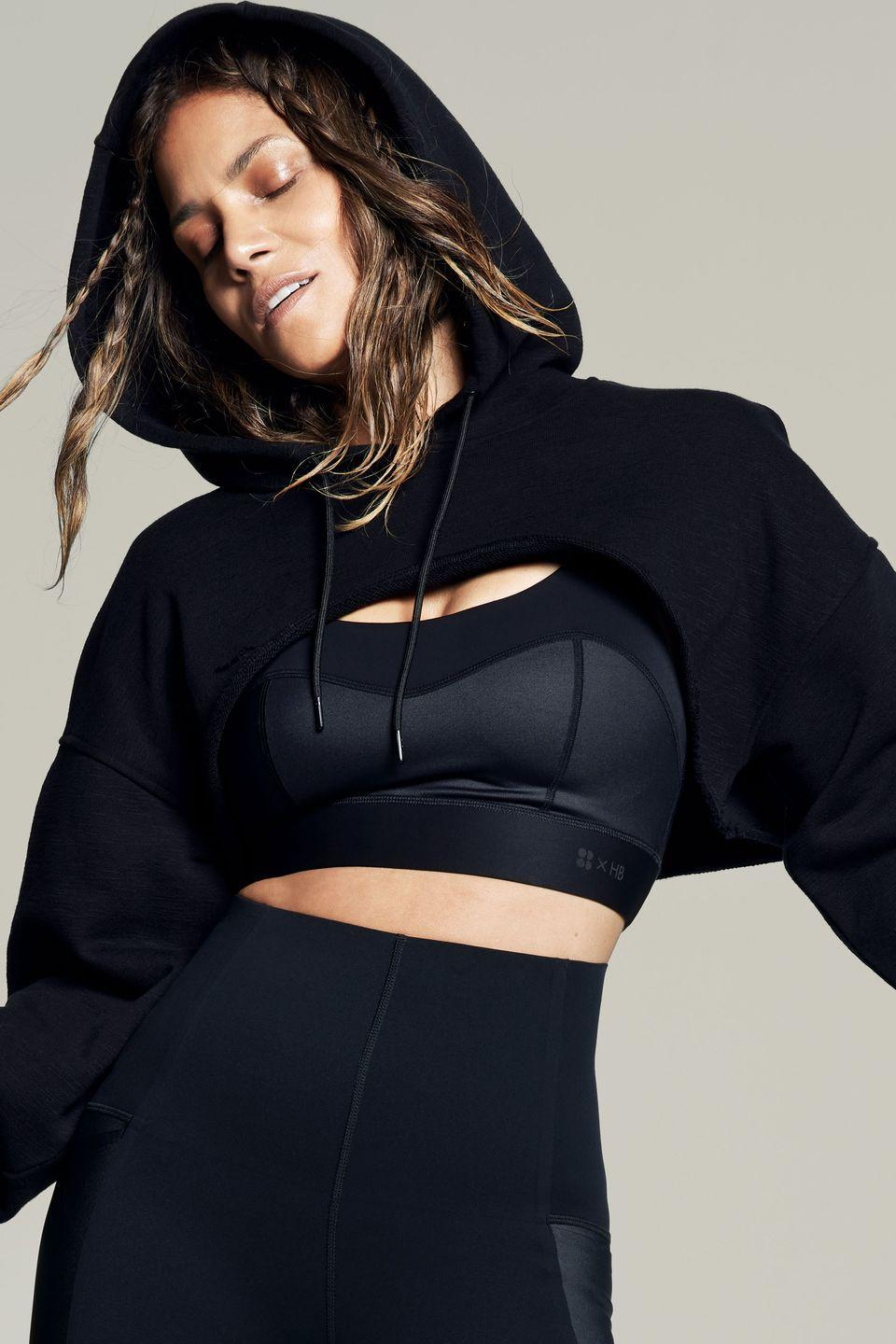 """<p>A sleek all-black set that feels a million dollars (just look at Halle's face. It says it all.) Made from premium technical materials this is about as luxe as sportswear gets.</p><p><strong>How much? </strong>Bra, £60, leggings, £75</p><p><a class=""""link rapid-noclick-resp"""" href=""""https://go.redirectingat.com?id=127X1599956&url=https%3A%2F%2Fwww.sweatybetty.com%2Fhalle-berry%2Fhalle-berry-edit%2Fstorm-power-shine-workout-bra-SB6905_Black.html&sref=https%3A%2F%2Fwww.womenshealthmag.com%2Fuk%2Fgym-wear%2Fg36447378%2Fsweaty-betty-halle-berry%2F"""" rel=""""nofollow noopener"""" target=""""_blank"""" data-ylk=""""slk:SHOP NOW"""">SHOP NOW</a></p>"""