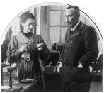 """FILE - In this undated file photo, pioneers of science Marie Curie and her husband Pierre are shown in their lab in France. Poland's prime minister says he's given instructions for the government to buy 790,000 euro house in France where the Nobel-winning scientist couple Marie Sklodowska-Curie and Pierre Curie spent vacation and weekends from 1904-1906. Premier Mateusz Morawiecki said on Twitter Wednesday, May 12, 2021 that the house, on the south-west outskirts of Paris, is a """"part of Poland's history."""" (AP Photo, file)"""