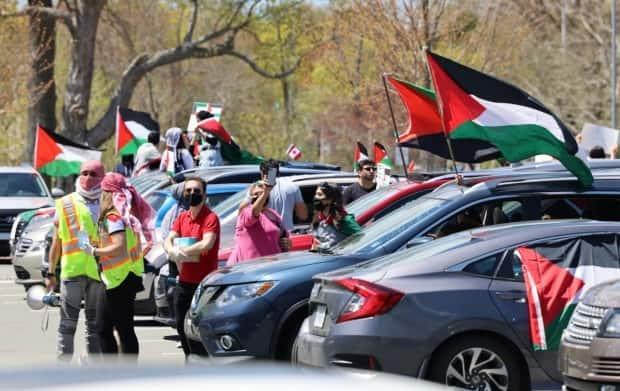 Police laid charges at the start of a car rally near Saint Mary's University in the south end of Halifax