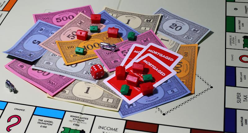 General view of money on a Monopoly Board. (Photo by Lynne Cameron/PA Images via Getty Images)