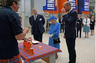 <p>William and the queen enjoy a taste of the Irn-Bru drink at the factory in Cumbernauld, Scotland.</p>