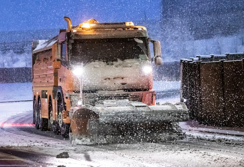 A snowplough on the road at Leeming Bar in North Yorkshire (PA)