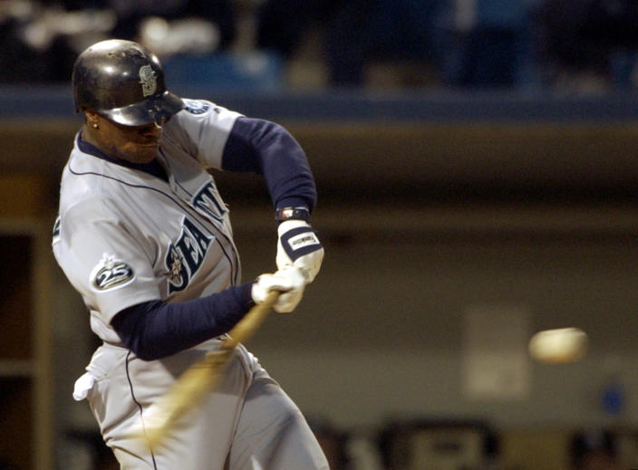 FILE - Seattle Mariners' Mike Cameron connects for his third home run of the game against the Chicago White Sox, in this May 2, 2002 file photo taken in Chicago. Josh Hamilton's historic slugfest Tuesday night May 8, 2012 in Baltimore made him the 16th player in major league history with four homers in a game. Here's how his big night stacks up against the rest. (AP Photo/Stephen J. Carrera, File)