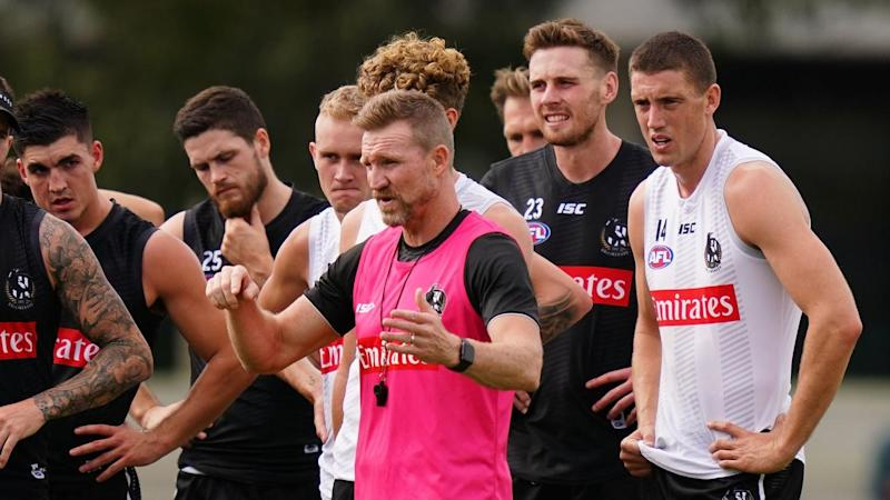 Nathan Buckley (c) is looking forward to getting his Collingwood AFL players back on the field