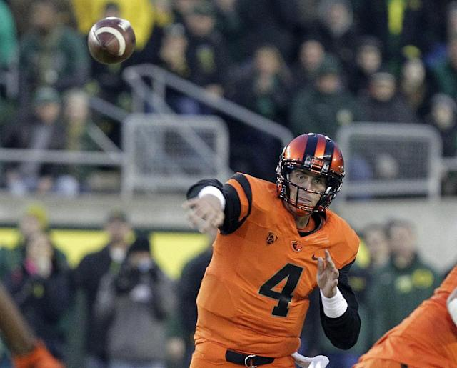 Oregon State quarterback Sean Mannion throws during the first half of an NCAA college football game against Oregon in Eugene, Ore., Friday, Nov. 29, 2013. (AP Photo/Don Ryan)