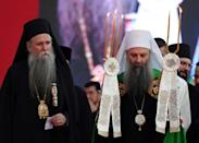 Joanikije (L) and Patriarch Porfirije (R) were dropped off by helicopter on the monastery's lawn and rushed in under the sound of bells (AFP/SAVO PRELEVIC)