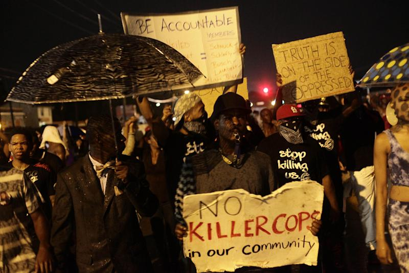Demonstrators protest Michael Brown's murder August 16, 2014 in Ferguson, Missouri
