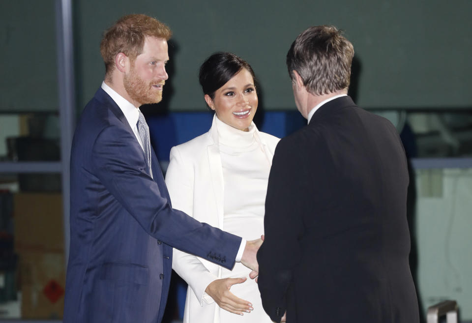 The Duke and Duchess of Sussex arrive at the Natural History Museum in London [Photo: Getty]