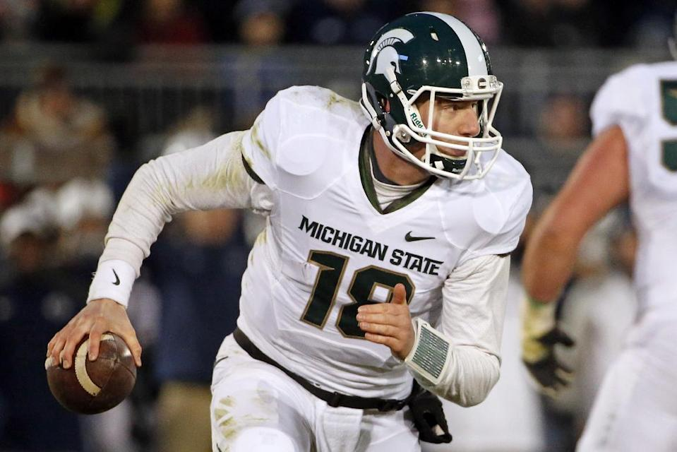 Michigan State quarterback Connor Cook (18) rolls out looking to pass during the second half of an NCAA college football game against Penn State in State College, Pa., Saturday, Nov. 29, 2014. (AP Photo/Gene J. Puskar)