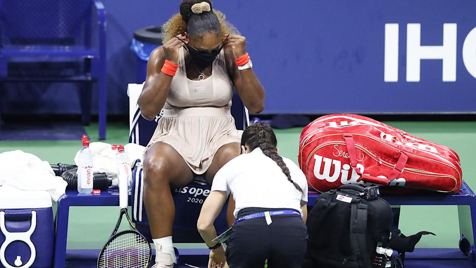 Serena Williams, pictured here having her ankle re-taped in the third set against Victoria Azarenka.