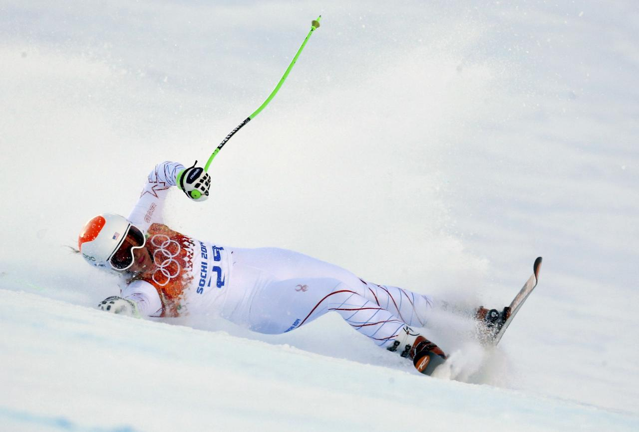 Stacey Cook of the U.S. crashes during the women's alpine skiing Super G competition at the 2014 Sochi Winter Olympics at the Rosa Khutor Alpine Center February 15, 2014. REUTERS/Ruben Sprich (RUSSIA - Tags: SPORT SKIING OLYMPICS)