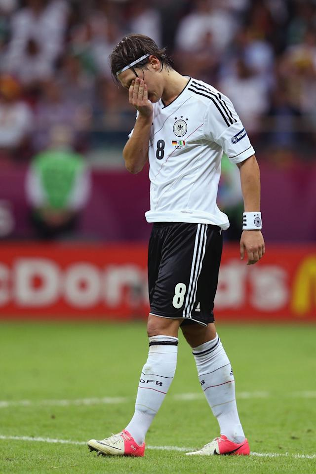 WARSAW, POLAND - JUNE 28: Mesut Ozil of Germany shows his dejection during the UEFA EURO 2012 semi final match between Germany and Italy at the National Stadium on June 28, 2012 in Warsaw, Poland. (Photo by Alex Grimm/Getty Images)