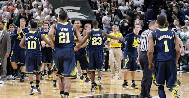 Michigan players celebrate their 80-75 win over Michigan State in an NCAA college basketball game, Saturday, Jan. 25, 2014, in East Lansing, Mich. (AP Photo/Al Goldis)