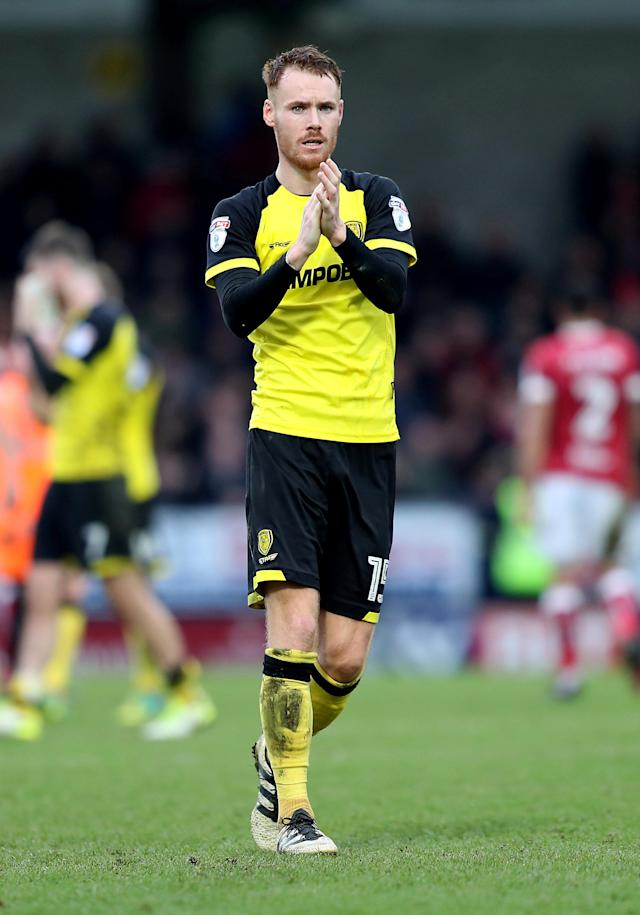 "Soccer Football - Championship - Burton Albion vs Bristol City - Pirelli Stadium, Burton-on-Trent, Britain - March 10, 2018 Burton Albion's Tom Naylor applauds the fans at the end of the game Action Images/John Clifton EDITORIAL USE ONLY. No use with unauthorized audio, video, data, fixture lists, club/league logos or ""live"" services. Online in-match use limited to 75 images, no video emulation. No use in betting, games or single club/league/player publications. Please contact your account representative for further details."