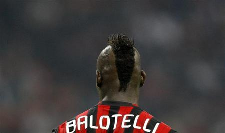 AC Milan's Balotelli reacts during the match against Napoli in their Italian Serie A soccer match at the San Siro stadium in Milan