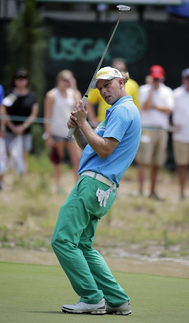Marcel Siem, of Germany, reacts after missing a putt on the fourth hole during the third round of the U.S. Open golf tournament in Pinehurst, N.C., Saturday, June 14, 2014. (AP Photo/Eric Gay)