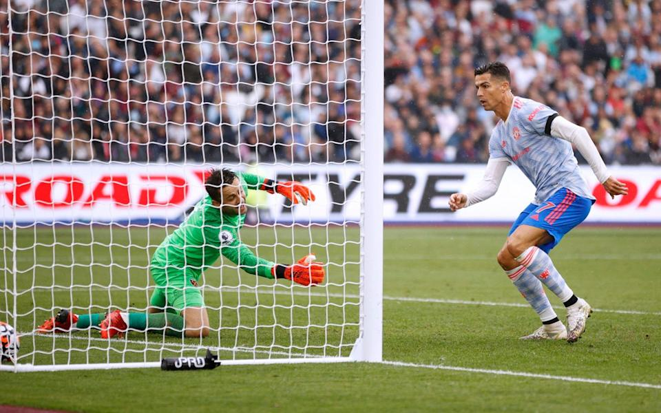 Manchester United's Cristiano Ronaldo scores their first goal - Reuters