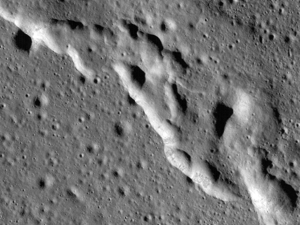In this image taken by NASA's Lunar Reconnaissance Orbiter (LRO), a mosaic composed of many images, wrinkle ridges are seen in a region of the Moon called Mare Frigoris (AFP Photo/HO)