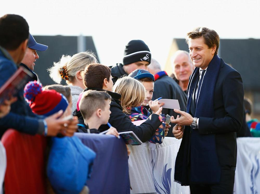 Parish signs autographs for fans (Getty)