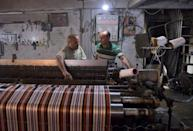 Syrian men work at a workshop in Aleppo. Syrians in government-held areas have had to adapt their lives at home and work around power cuts of up to 20 hours a day (AFP/-)