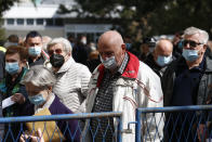 Residents wait to receive a dose of the AstraZeneca vaccine in Zagreb, Croatia, Thursday, April 8, 2021. Croatia has reported a surge in new coronavirus cases as the EU-member nation faces increasing public skepticism over the use of its main AstraZeneca shots. (AP Photo/Darko Bandic)