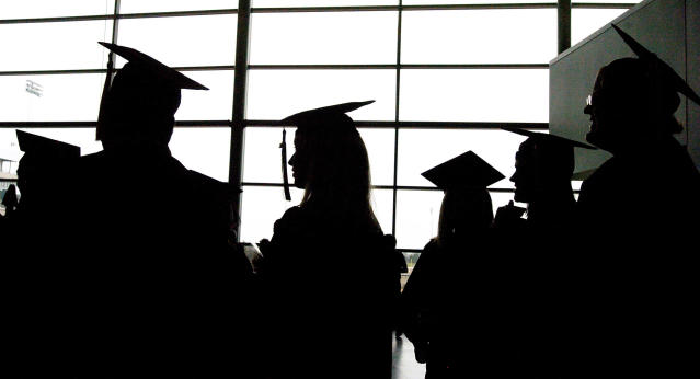 The silhouettes of graduate students. (AP Photo/The Ann Arbor News, Leisa Thompson)