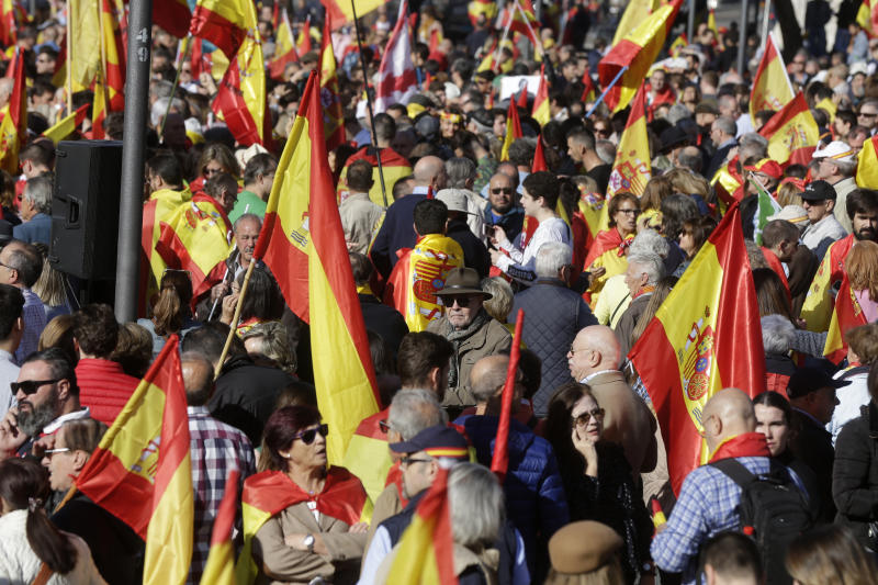 People with Spanish flags gather for a rally to promote 'Spanish Unity' during a rally by the right wing VOX party in Madrid, Spain, Saturday, Oct. 26, 2019. The VOX rally comes 2 days after the exhumation and reburial of Spanish dictator Gen. Francisco Franco from the grandiose Valley of the Fallen mausoleum outside Madrid to their new resting place at the Mingorrubio cemetery, 57 kilometers (35 miles) away. (AP Photo/Paul White)