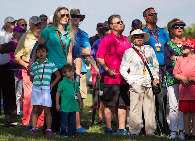 Lindsey Vonn, joined by Tiger Woods' children, Sam Alexis and Charlie Axel, watches Woods tee off on the 11th hole during the second round of the Honda Classic golf tournament in Palm Beach Gardens, Fla., Friday, Feb. 28, 2014. (AP Photo/The Palm Beach Post, Allen Eyestone)