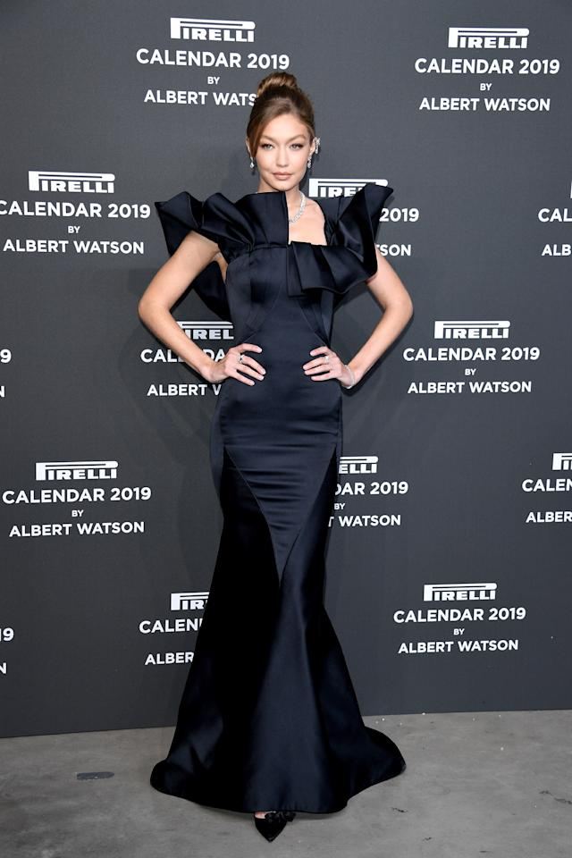 <p>The model stepped out in a form-fitting, fishtail dress with statement sleeves by US designer Zac Posen. <em>[Photo: Getty]</em> </p>