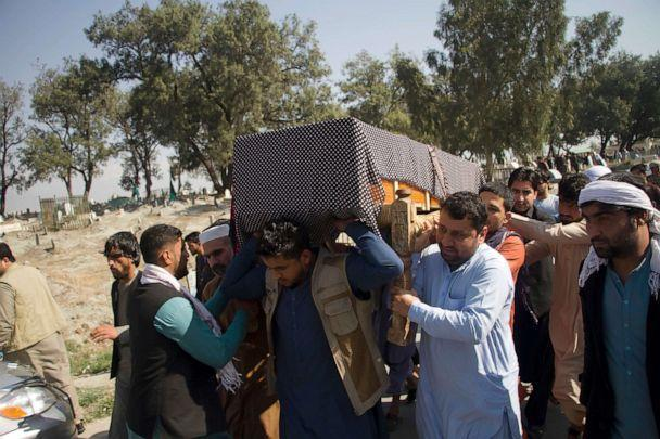PHOTO: Relatives carry the body of one of three women working for a local radio and TV station who were killed on Tuesday in attacks claimed by the Islamic State group, during her funeral ceremony in Jalalabad, east of Kabul, Afghanistan, March 3, 2021. (AP)