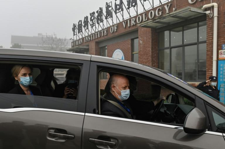Peter Daszak (R), Thea Fischer (L) and other members of the World Health Organization team investigating the origins of COVID-19, arrive at the Wuhan Institute of Virology